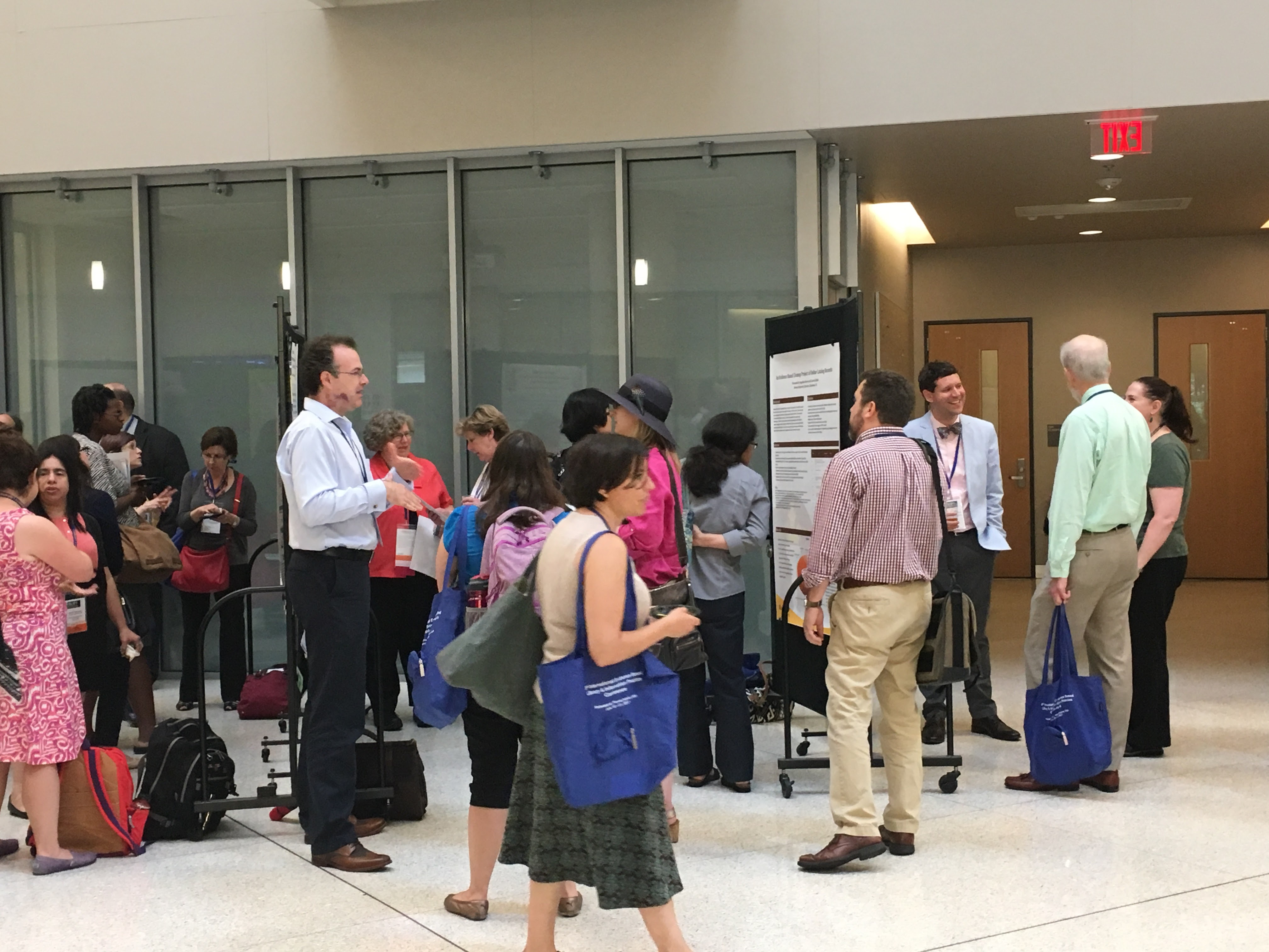 Conference attendees examine poster sessions in the PISB atrium during EBLIP9