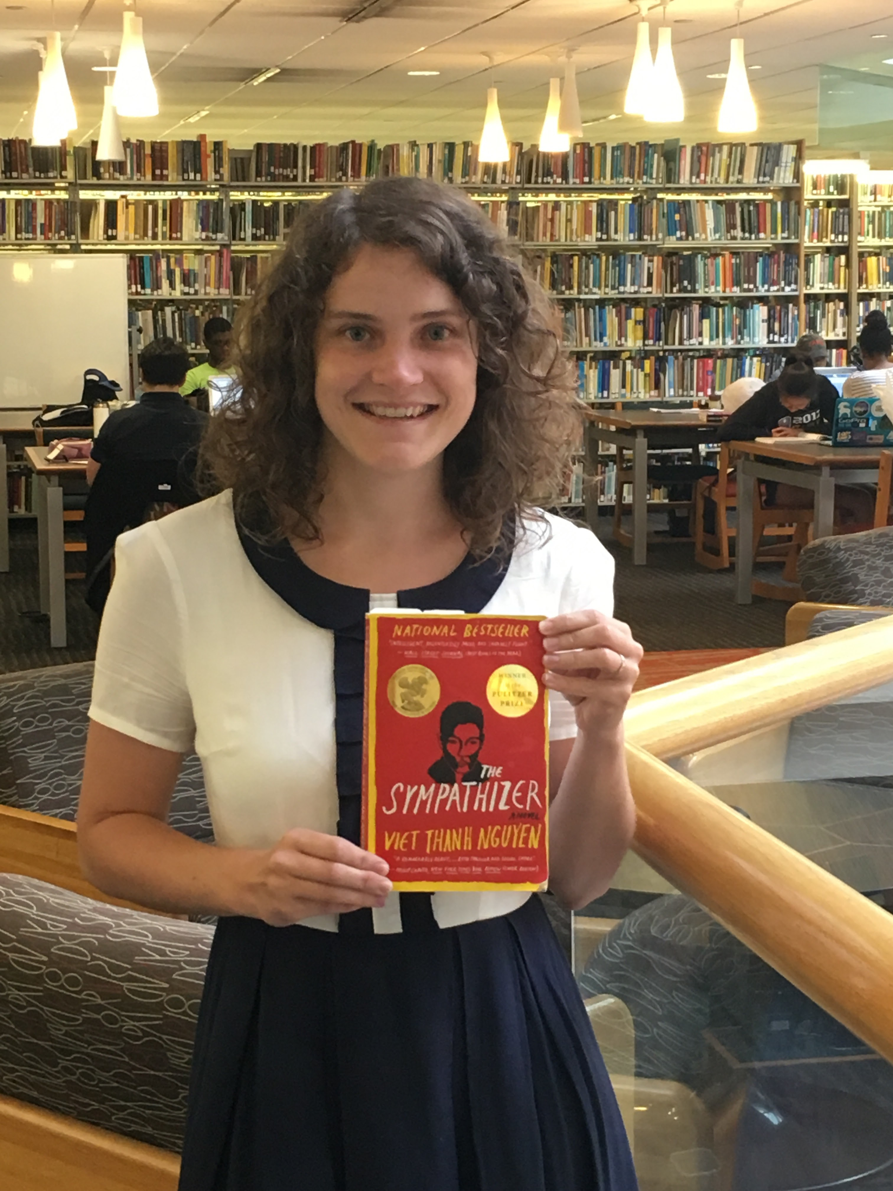 Sarah Rich holds a copy of the book 'The Sympathizer' by Viet Thanh Nguyen