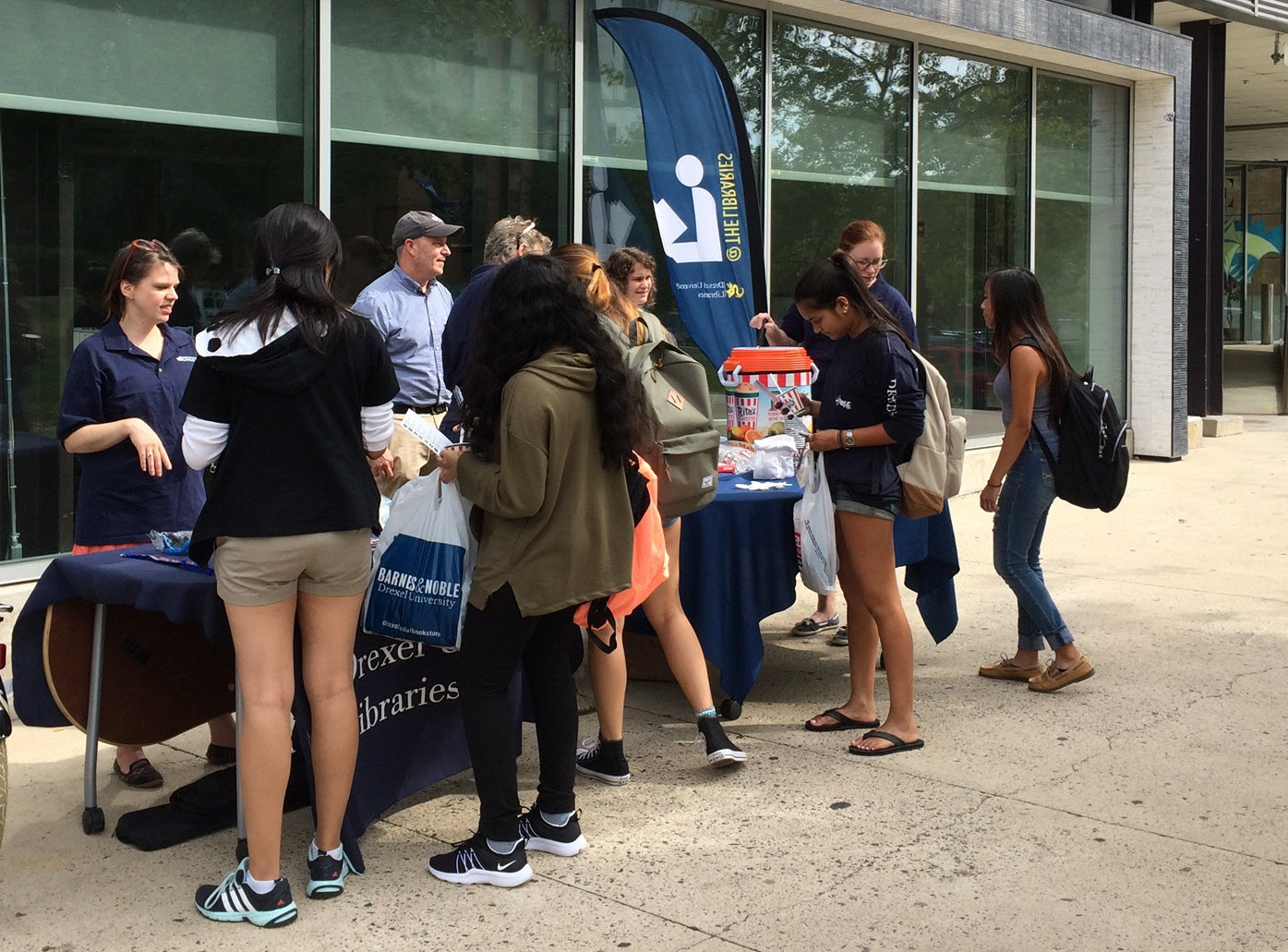 Drexel students wait in line for water ice in front of the Library Learning Terrace