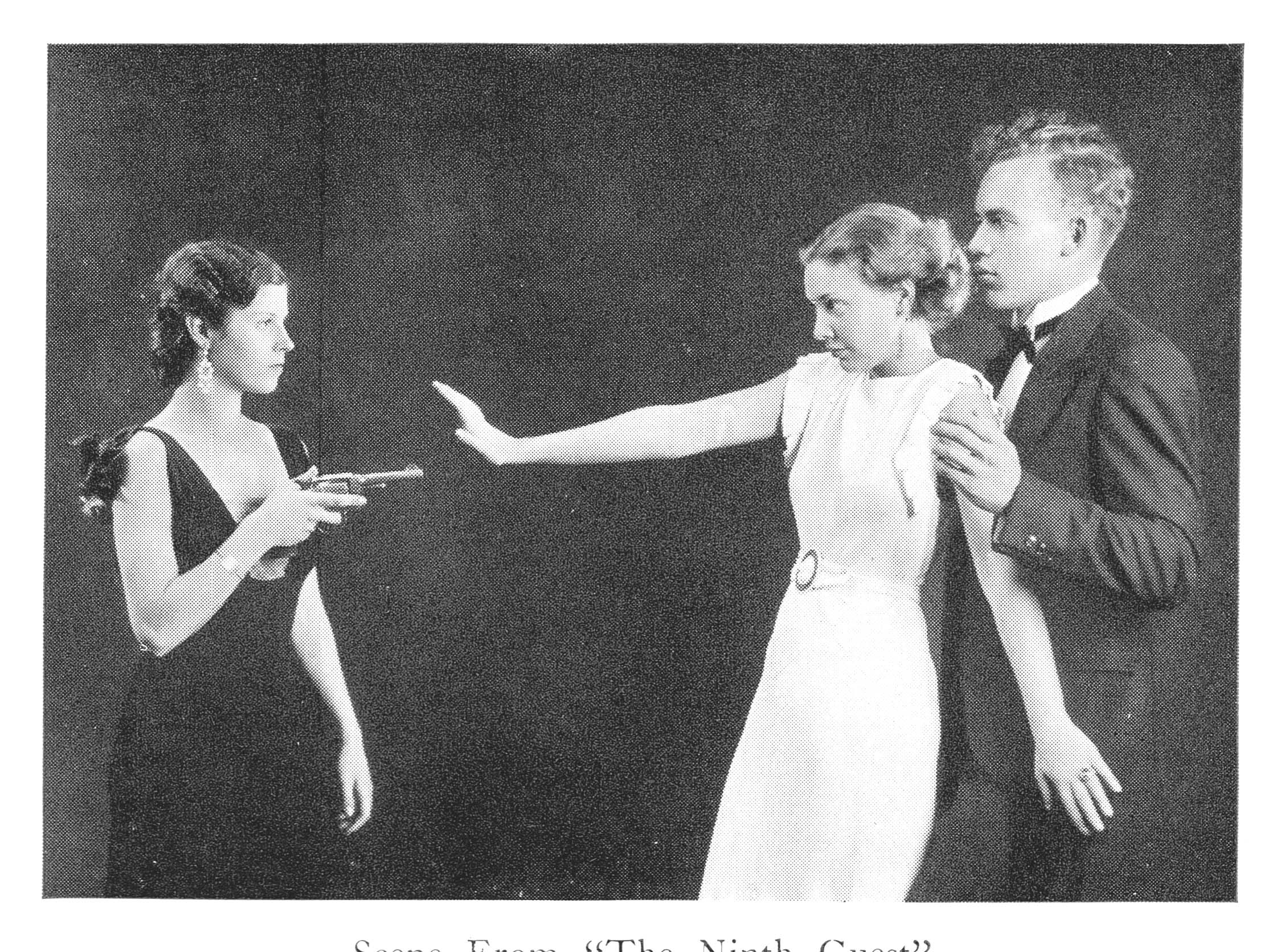 A woman points a prop gun at another woman and a man during a Drexel theater production