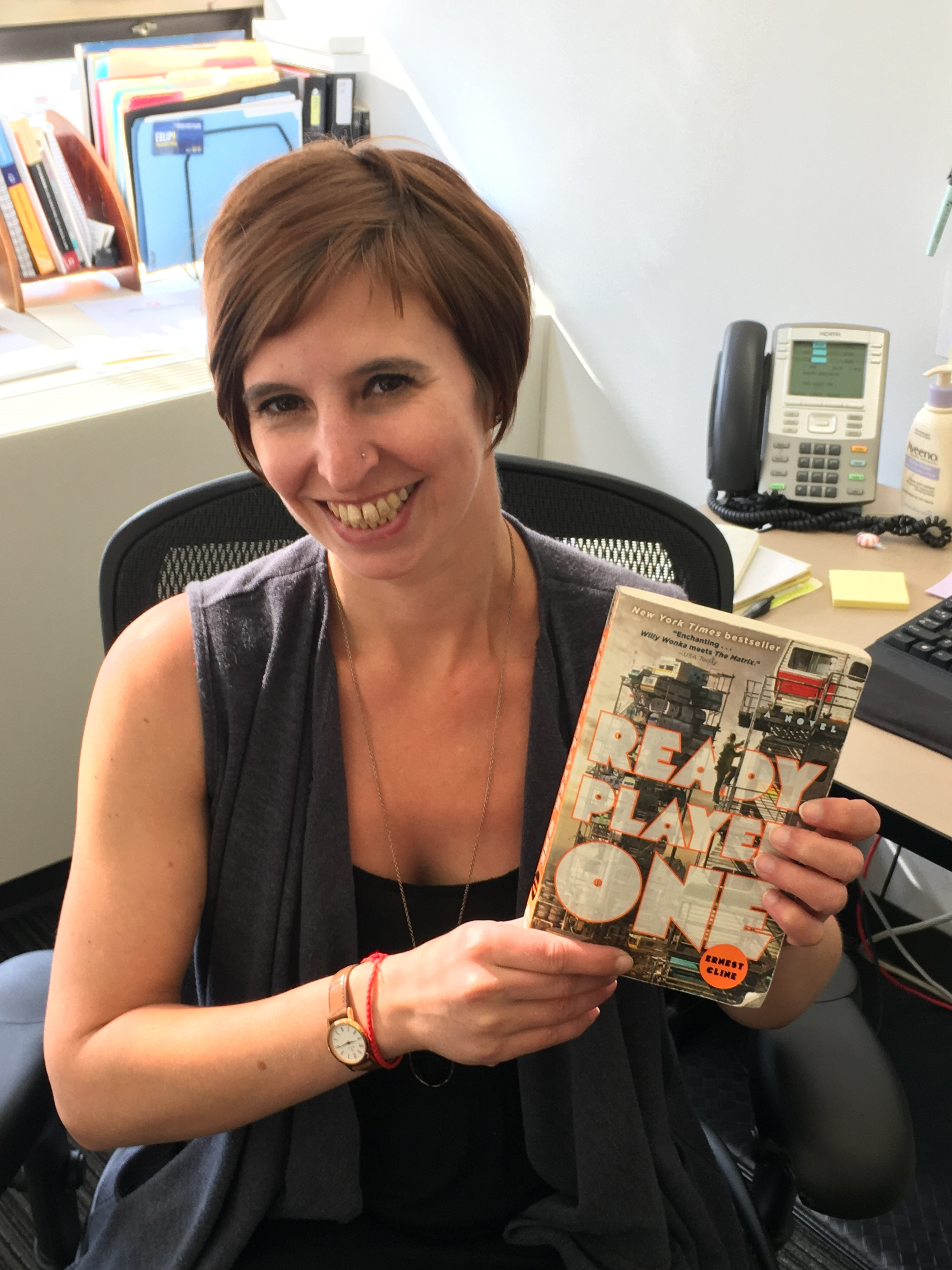 Stacy Stanislaw holds a copy of the novel 'Ready Player One'